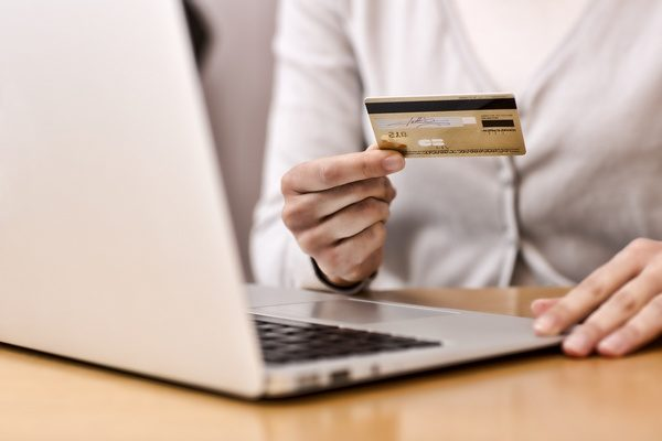 close-up-womans-hands-holding-a-credit-card